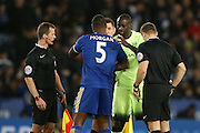 Manchester City midfielder Yaya Toure  and Leicester City defender Wes Morgan  shake hands before the game during the Barclays Premier League match between Leicester City and Manchester City at the King Power Stadium, Leicester, England on 29 December 2015. Photo by Simon Davies.