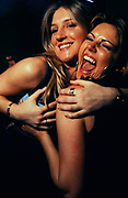 Two happy female clubbers embrace, London, U.K,1999.