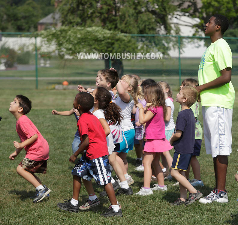 Middletown, New York - Children and a counselor watch the ball during a soccer game at Middletown YMCA summer camp on August 20, 2010.