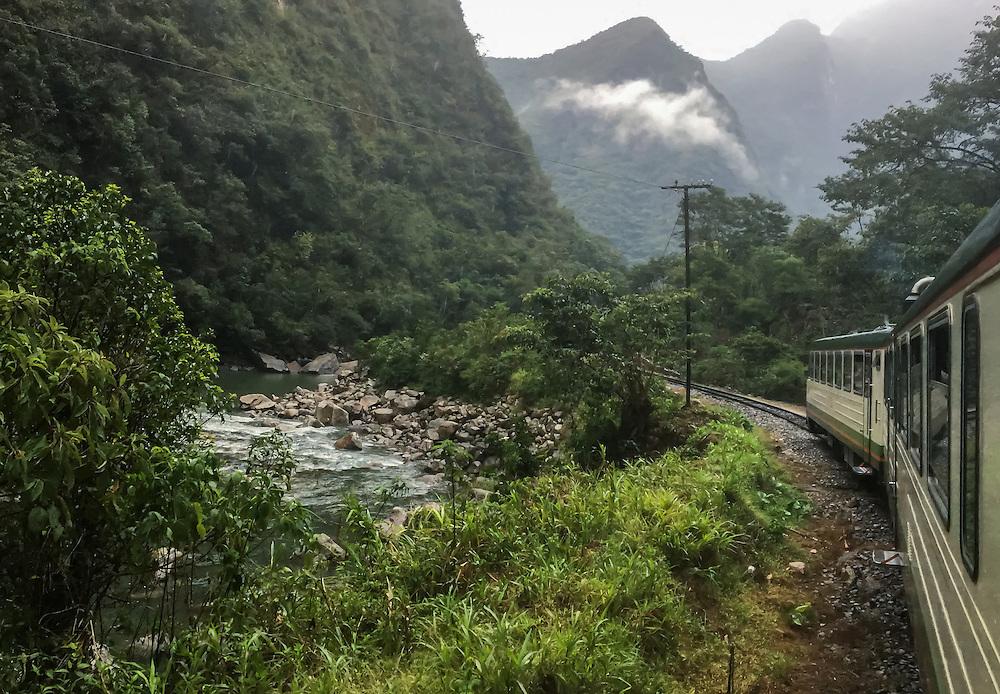 CUSCO, PERU - CIRCA OCTOBER 2015:  Inca Rail convoy around the Sacred Valley on the way to Ciudad Machu Picchu