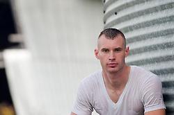 portrait of a man in a wet tee shirt