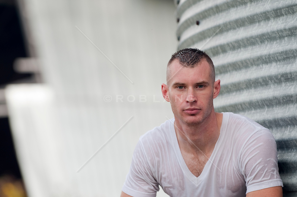 portrait of a man in a wet tee shirt