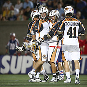 Mark Cockerton #41 of the Rochester Rattlers and other members of the Rochester Rattlers celebrate a goal during the game at Harvard Stadium on August 9, 2014 in Boston, Massachusetts. (Photo by Elan Kawesch)