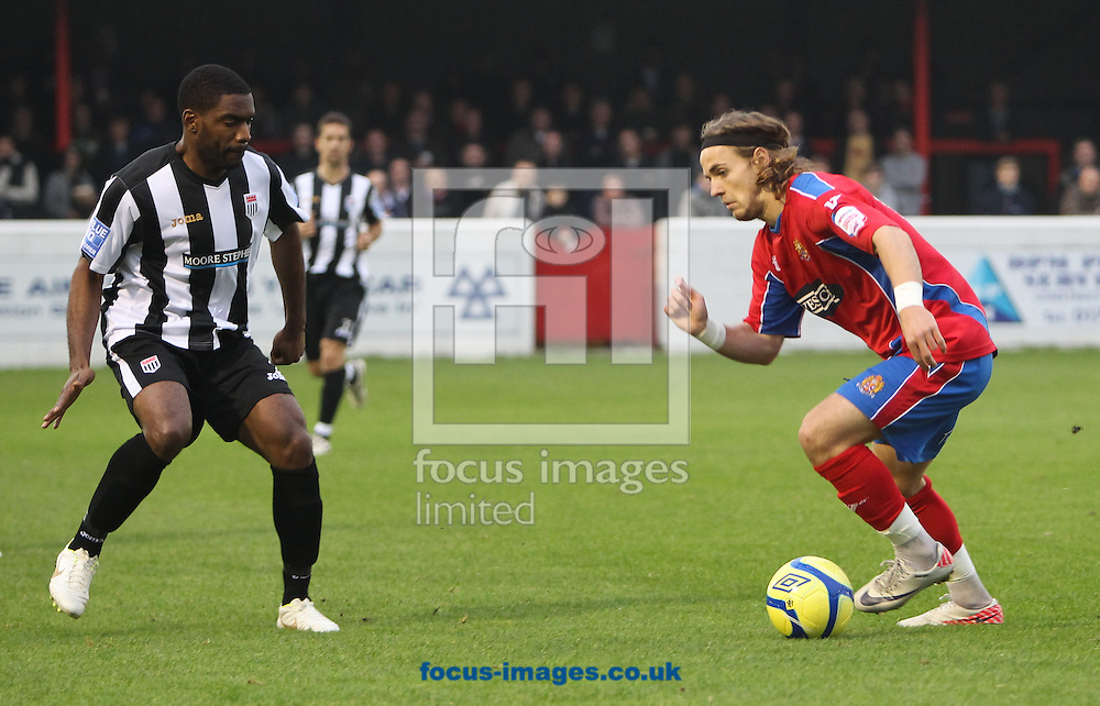 Picture by John Rainford/Focus Images Ltd. 07506 538356.12/11/11.Danny Green of Dagenham & Redbridge and Sekani Simpson of Bath City during the FA Cup 1st round match at Victoria Road stadium, Dagenham.