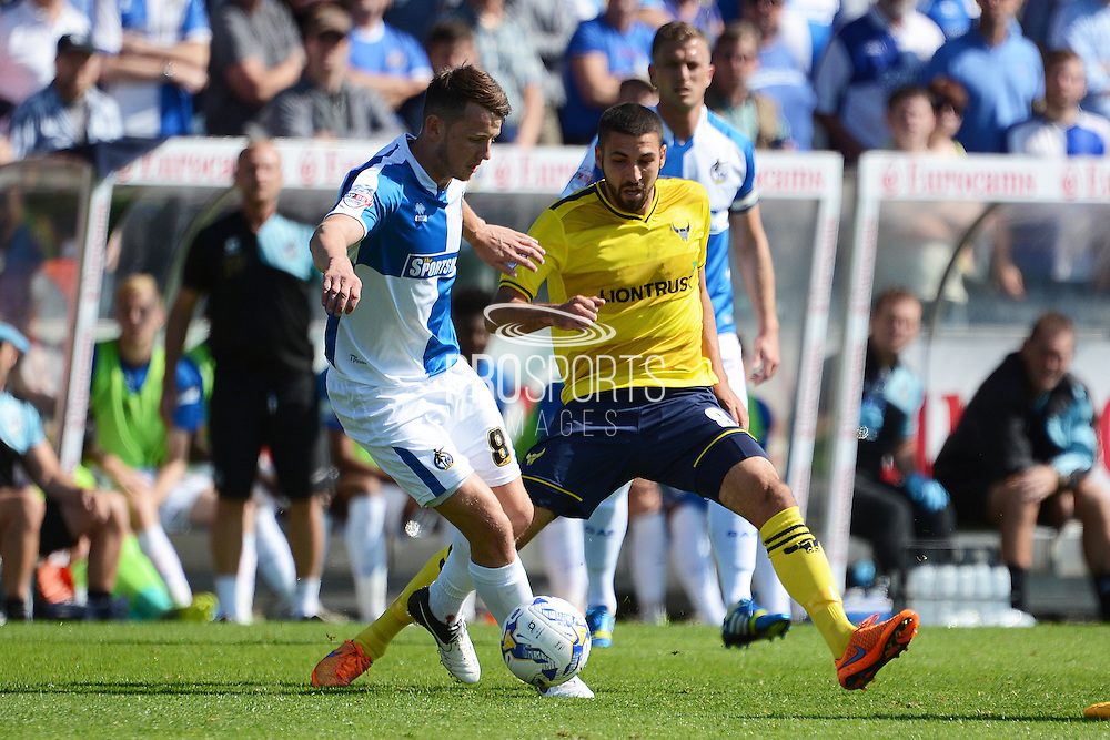 Ollie Clarke and Liam Sercombe tussle for the ball during the Sky Bet League 2 match between Bristol Rovers and Oxford United at the Memorial Stadium, Bristol, England on 6 September 2015. Photo by Alan Franklin.