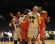 """Auburn's Jordan Greenleaf (21), Mississippi's Kayla Melson, Auburn's Morgan Toles (1), and Mississippi's Elizabeth Robertson (14) battle for the ball in women's college basketball at the C.M. """"Tad"""" SMith Coliseum in Oxford, Miss. on Thursday, February 25, 2010."""