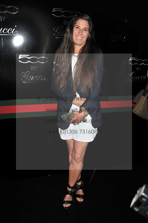 ELIZABETH SALTZMAN at a party to launch the Gucci designed Fiat 500 customized by Gucci Creative Director Frida Giannini in collaboration with FIAT's Centro Stile, held at Fiat, 105 Wigmore Street, London on 27th June 2011.