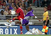 Fotball<br /> Frankrike 2004/05<br /> Toulouse v Paris Saint Germain<br /> 21. august 2004<br /> Foto: Digitalsport<br /> NORWAY ONLY<br /> FABRICE FIORESE (PSG) / HENRI BEDIMO N'SAME (TOU)