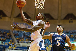 Nov 11, 2016; Morgantown, WV, USA; West Virginia Mountaineers guard Teyvon Myers (0) shoots under the basket during the second half against the Mount St. Mary's Mountaineers at WVU Coliseum. Mandatory Credit: Ben Queen-USA TODAY Sports