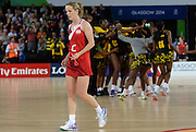 England centre Sara Bayman walks off dejected as Jamaica players celebrate defeating England in the Bronze medal playoff match. Glasgow Commonwealth Games at the SSE Hydro Glasgow, Scotland. Sunday 3 August 2014. Photo: Andrew Cornaga/www.Photosport.co.nz