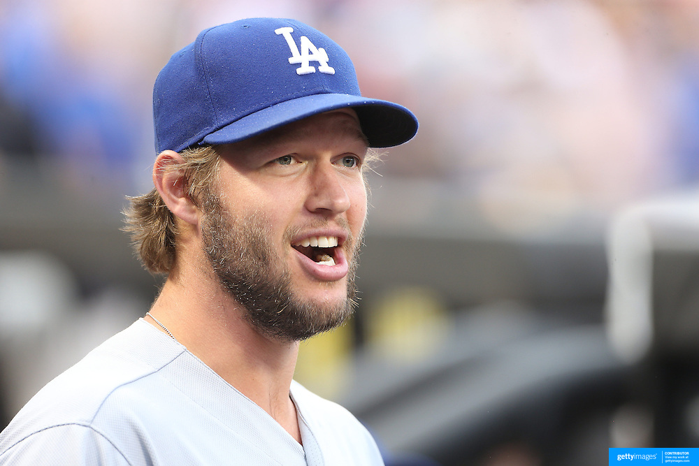NEW YORK, NEW YORK - May 27:  Clayton Kershaw #22 of the Los Angeles Dodgers sharing a joke with team mates in the dugout before the Los Angeles Dodgers Vs New York Mets regular season MLB game at Citi Field on May 27, 2016 in New York City. (Photo by Tim Clayton/Corbis via Getty Images)
