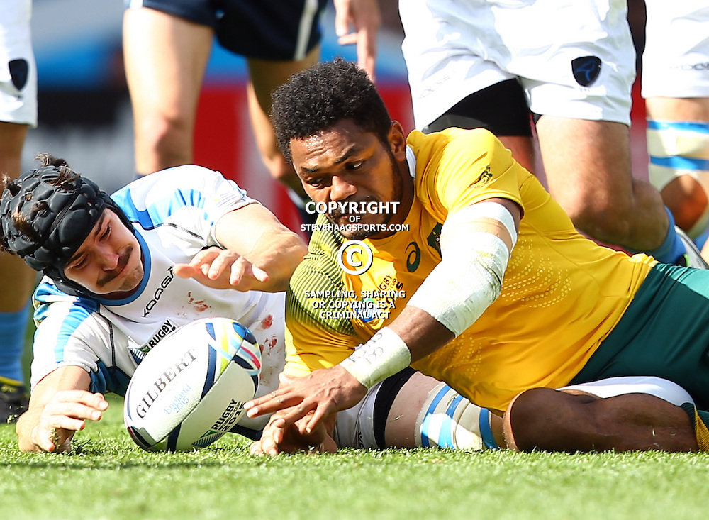 BIRMINGHAM, ENGLAND - SEPTEMBER 27: Matias Beer of Uruguay and Henry Speight of Australia both dive on the ball during the Rugby World Cup 2015 Pool A match between Australia and Uruguay at Villa Park on September 27, 2015 in Birmingham, England. (Photo by Steve Haag/Gallo Images)