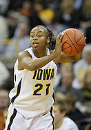 December 22 2010: Iowa guard Kachine Alexander (21) looks to pass the ball during the first half of an NCAA college basketball game at Carver-Hawkeye Arena in Iowa City, Iowa on December 22, 2010. Iowa defeated Northern Iowa 75-64.