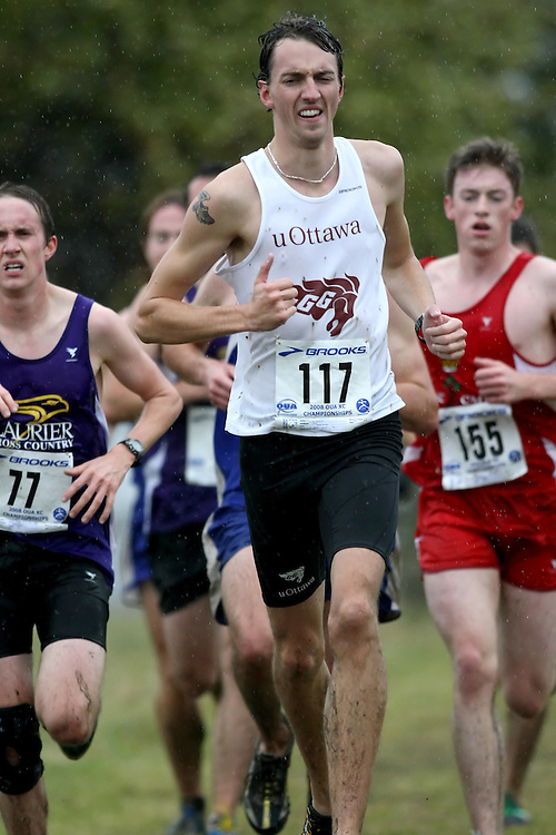 (Kingston, ON---25 October 2008) Kevin Brennan of OTTAWA University running to finish 75 in the 2008 Ontario University Athletics men's cross country championship.  Photograph copyright Sean Burges/Mundo Sport Images (www.msievents.com).