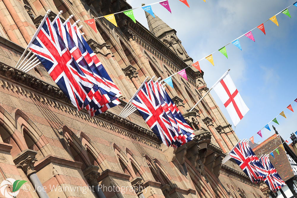 The British and English flags decorate Chester Town Hall on the day the Olympic Flame visited the city.