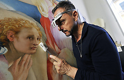 May 30, 2017 - Florence, Florence, Italy - An expert works on a masterpiece depicting The Deposition of Christ (oil painting on wood cm. 313 x 192 - 1526/1528) by the Italian Renaissance artist Jacopo da Carucci, better known as Jacopo da Pontormo or simply Pontormo, in the Capponi Chapel in the church of Santa Felicita. The Capponi Chapel was designed by Italian architect Filippo Brunelleschi (1377-1446), and was later decorated by a cycle of works by Pontormo. Restoration works on the Capponi Chapel and the Pontormo altarpiece 'The Deposition from the Cross' started in March 2017 and also include stone and wooden pieces, marble works, detached frescoes, and wall decorations. (Credit Image: © Giacomo Morini/Pacific Press via ZUMA Wire)