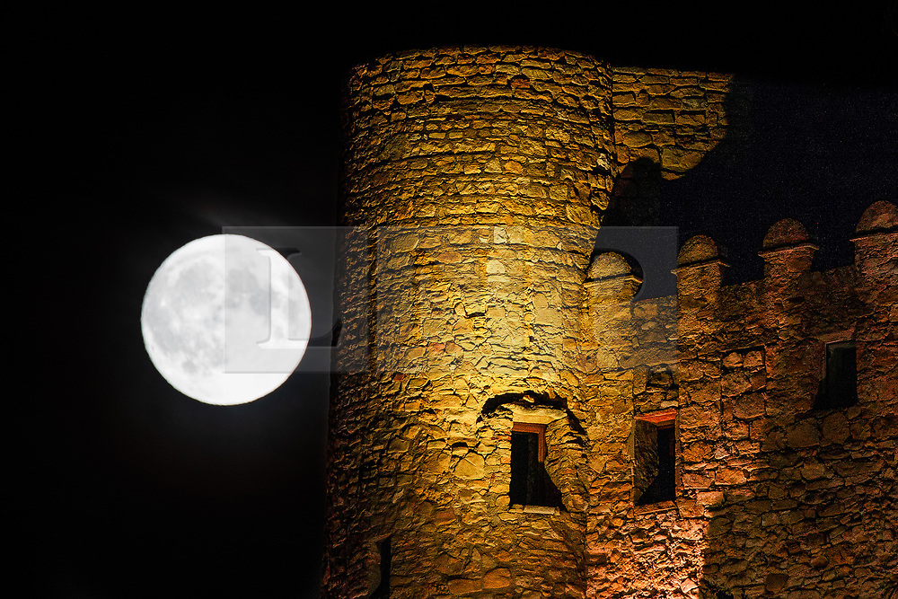 © Licensed to London News Pictures. 25/08/2018. Cassis, France. The Harvest Moon rises above Chateau de Cassis ( Cassis Castle ) in the South of France . The historical castle was built during the 14th and 15th centuries and is an icon of the landscape overlooking the 2,500 year old fishing settlement . The August full moon is also known as the Sturgeon Moon . Photo credit : Joel Goodman/LNP