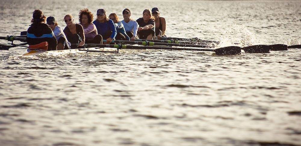 JEROME A. POLLOS/Press..The Coeur d'Alene Rowing team powers across the surface of Fernan Lake during a training session Monday. The eight-person team travels throughout the northwest to compete in rowing competitions.