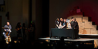 """Artist in Residence Andrew Periale narrates """"Scenes from Ancient Pompeii"""" with Gilmanton 6th grade students operating their puppets during Wednesday afternoon's performance.  (Karen Bobotas/for the Laconia Daily Sun)"""