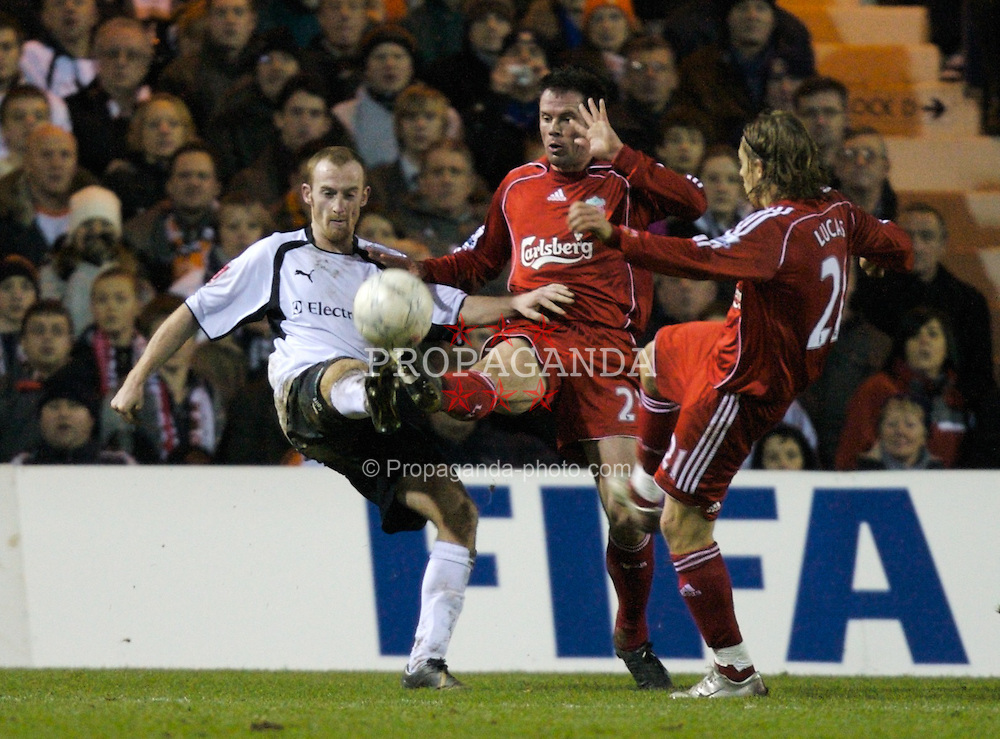 LUTON, ENGLAND - Sunday, January 6, 2008: Liverpool's Jamie Carragher and Lucas Levia and Luton Town's Chris Perry during the FA Cup 3rd Round match at Keniworth Road. (Photo by David Rawcliffe/Propaganda)