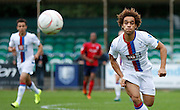 Reise Allassani chasing down the loose ball during the Pre-Season Friendly match between Hampton & Richmond and Crystal Palace at Beveree Stadium, Richmond Upon Thames, United Kingdom on 27 July 2015. Photo by Michael Hulf.