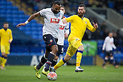 Bolton Wanderers midfielder Liam Trotter under pressure Mirco Antenucci of Leeds Unitedfrom during the The FA Cup fourth round match between Bolton Wanderers and Leeds United at the Macron Stadium, Bolton, England on 30 January 2016. Photo by Simon Brady.