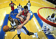 Washington Wizards' John Wall goes up for a basket against New York Nets Kris Humphries at the Verizon Center in Washington, D.C.