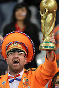 CAPE TOWN, SOUTH AFRICA- Tuesday 6 July 2010, a Dutch fan with a replica of the world cup trophy during the semi final match between Uruguay and the Netherlands (Holland) held at the Cape Town Stadium in Green Point during the 2010 FIFA World Cup..Photo by Roger Sedres/Image SA