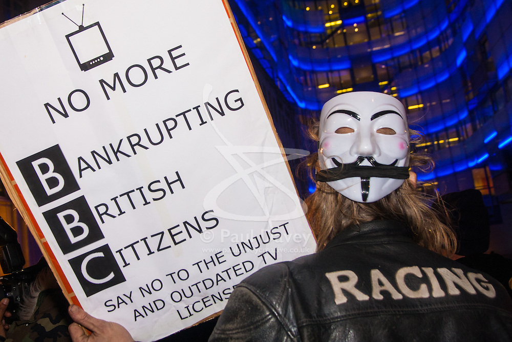 """London, December 23rd 2014. Online activism group Anonymous march through London from the City to the BBC's HQ on Great Portland Street in protest against alleged biases and coverups of a """"paedophile ring"""". PICTURED: Some Anonymous activists protest against the BBC's licence fee."""