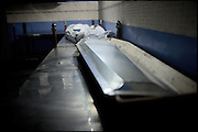 "A coffin and two dead bodies in the morgue refrigerator cell, Edhi Foundation Clinic. Every day arrive at the Center bodies of addicts died from drug-related issues. Karachi, Pakistan, on sunday, December 07 2008.....""Pakistan is one of the countries hardest hits by the narcotics abuse into the world, during the last years it is facing a dramatic crisis as it regards the heroin consumption. The Unodc (United Nations Office on Drugs and Crime) has reported a conspicuous decline in heroin production in Southeast Asia, while damage to a big expansion in Southwest Asia. Pakistan falls under the Golden Crescent, which is one of the two major illicit opium producing centres in Asia, situated in the mountain area at the borderline between Iran, Afghanistan and Pakistan itself. .During the last 20 years drug trafficking is flourishing in the Country. It is the key transit point for Afghan drugs, including heroin, opium, morphine, and hashish, bound for Western countries, the Arab states of the Persian Gulf and Africa..Hashish and heroin seem to be the preferred drugs prevalence among males in the age bracket of 15-45 years, women comprise only 3%. More then 5% of whole country's population (constituted by around 170 milion individuals),  are regular heroin users, this abuse is conspicuous as more of an urban phenomenon. The substance is usually smoked or the smoke is inhaled, while small number of injection cases have begun to emerge in some few areas..Statistics say, drug addicts have six years of education. Heroin has been identified as the drug predominantly responsible for creating unrest in the society."""