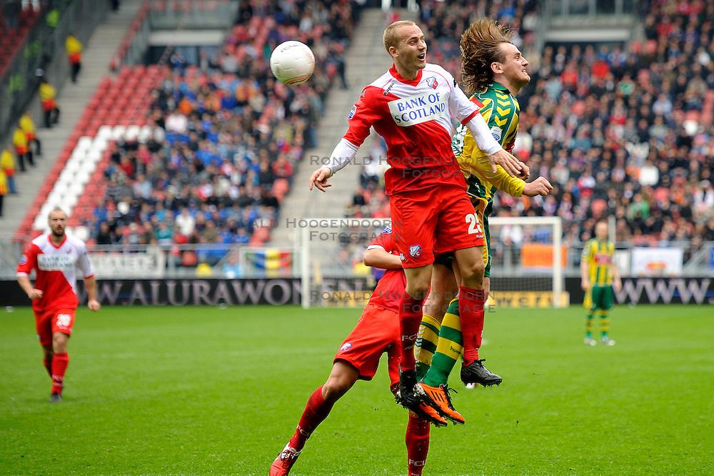 03-04-2011 VOETBAL: FC UTRECHT - ADO DEN HAAG: UTERCHT<br /> (L-R) Ismo Vorstermans, Dmitry Bulykin<br /> &copy; Ronald Hoogendoorn Photography