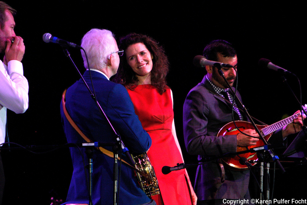 """August 2, 2013 - Comedian Steve Martin, performed at Snowden Grove Amphitheater, Saturday evening, in his more current role as a blue grass musician. He is touring with the North Carolina bluegrass band the Steep Canyon Rangers and singer-musician Edie Brickell (left). He did use every opportunity to still get a laugh, while performing with his banjo. The Martin-Brickell the pair has collaborated on a musical together. """"Bright Star,"""" based on an original story by the two set in the Blue Ridge Mountains in the early 20th century, will have its world premiere September 13 at the Old Globe Theater in San Diego, California."""