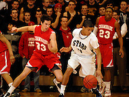 5 MARCH 2011 -- NORMANDY, Mo --  Chaminade College Prep basketball player Giovanni Ferrara (33) pressures McCluer North High School's Tremayne Garrett (23) during the MSHSAA Class 5 boys basketball quarterfinals at Mark Twain Hall on the University of Missouri - St. Louis campus in Normandy, Mo. Saturday, March 5, 2011. The Stars upset the Red Devils 57-56 to advance to MSHSAA semifinals. Image © copyright 2011 Sid Hastings.