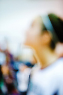 Out of focus profile of girl with headband on.