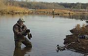 James Pratt setting duck decoys on lake