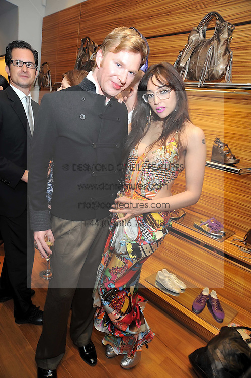 HENRY CONWAY and NAMALEE BOLLE at a party in aid of the charity Best Buddies held at the Hogan store, 10 Sloane Street, London SW10 on 13th May 2009.