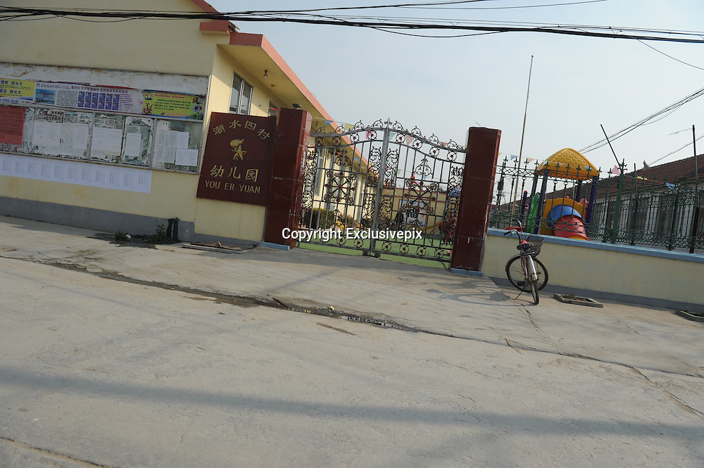 PENGLAI, CHINA - NOVEMBER 19: (CHINA OUT) <br /> <br /> 11 Children Killed In School Bus Accident In East China<br /> <br /> The image shows the front gate of the Kindergarten of Chaoshui Sicun which 11 children from this kindergarten died during a traffic accident on November 19, 2014 in Penglai, Shandong Province of China. 11 kindergarten children and 1 driver died and 3 kindergarten children were injured during a collision between a truck and a minibus on the slip road to the new Yantai airport in Chaoshui Town, Penglai City of East China\'s Shandong Province. The minibus belonged to a local private kindergarten and was overloaded at that time according to Xinhua's report. The cause of the traffic is still under investigation. ©Exclusivepix