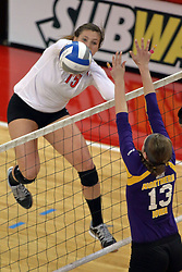 17 October 2014:  Ashley Rosch strikes past Kayla Haneline during an NCAA Missouri Valley Conference (MVC) womens volleyball match between the Northern Iowa Panthers and the Illinois State Redbirds for 1st place in the conference at Redbird Arena in Normal IL