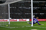 Sheffield Wednesday goalkeeper Cameron Dawson (25) is beaten from the penalty spot by Derby County forward Chris Martin (19) during the EFL Sky Bet Championship match between Derby County and Sheffield Wednesday at the Pride Park, Derby, England on 11 December 2019.