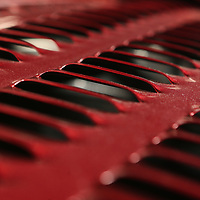 The louvered hood of a 1951 Chevrolet two door coupe. Each louver was hand stamped.