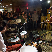 TAKOMA PARK, MD  - JAN 25:  New York based Spirit Family Reunion, perform at the VFW post in Takoma Park, Maryland, January 25, 2014. VFW Posts are dying all across the country but in the unlikely liberal haven of Takoma Park, the old VFW is showing signs of life. By throwing open the doors to private parties and concerts, the club is breaking even in spite of dwindling membership. Several times a month, the bar dwelling regular vets are sharing space with the bureaucrats, activists and peaceniks from the surrounding neighborhood. (Photo by Evelyn Hockstein/For The Washington Post)
