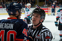 KELOWNA, CANADA - DECEMBER 27: Linesman Tim Plamondon escorts Brady Reagan #40 of the Kamloops Blazers to the bench against the Kelowna Rockets on December 27, 2017 at Prospera Place in Kelowna, British Columbia, Canada.  (Photo by Marissa Baecker/Shoot the Breeze)  *** Local Caption ***