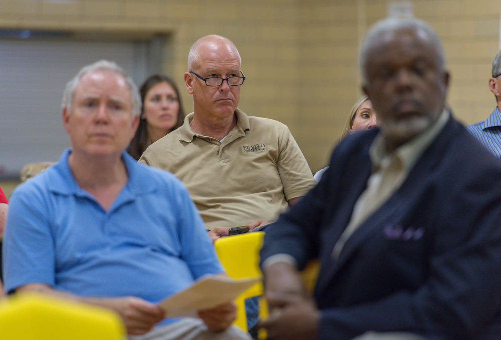 Houston ISD staff, representatives of VLK Architects and Jamail & Smith Construction discuss the progress on the Condit Elementary School project during a community meeting, June 10, 2014.