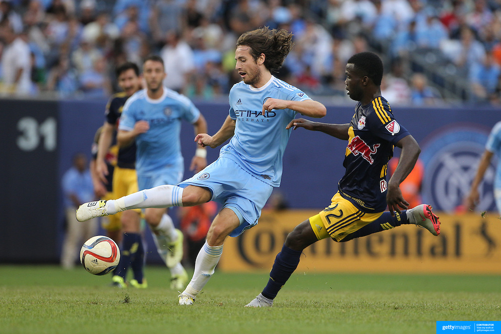 Mix Diskerud, (left), NYCFC, is challenged by Kemar Lawrence, New York Red Bulls, during the New York City FC Vs New York Red Bulls, MSL regular season football match at Yankee Stadium, The Bronx, New York,  USA. 28th June 2015. Photo Tim Clayton