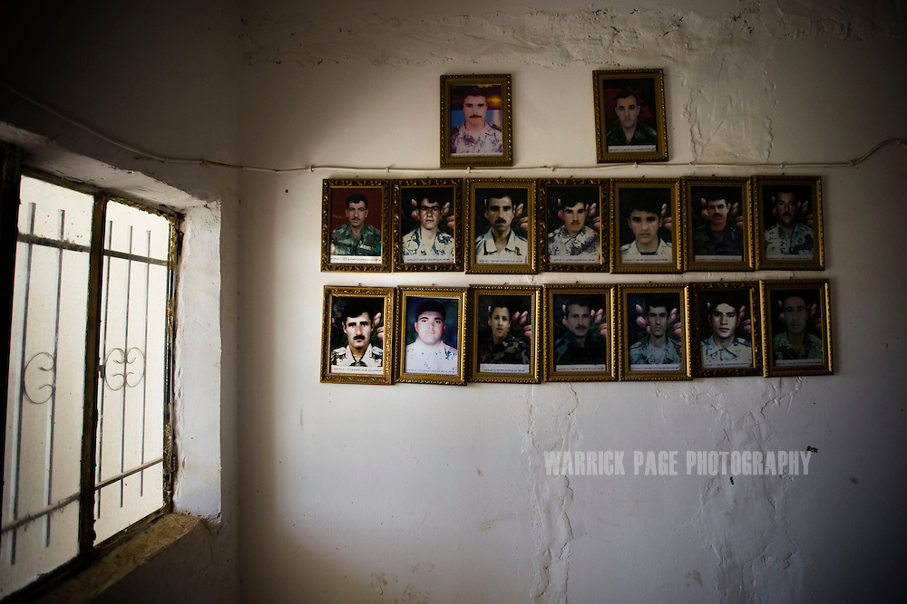 AL GUWAIR, IRAQ - JUNE 02: Photos of Iraqi soldiers killed in the line of duty adorn the entrance to an Iraqi Army base, on June 2 , 2010, near Al Guwair, south of Mosul, Iraq. Iraq faces multiple challenges in the lead-up to the drawn-down of US forces in Iraq, with many observers claiming that while they have the capablities of handling home-grown problems, they are far from being able to tackle external threats. Political wrangling has reportedly fostered greater instability throughout the country with fears of renewed sectarian violence breaking out as insurgents set-up attacks in an attempt to exploit vulnerabilities amongst the populace. (Photo by Warrick Page)