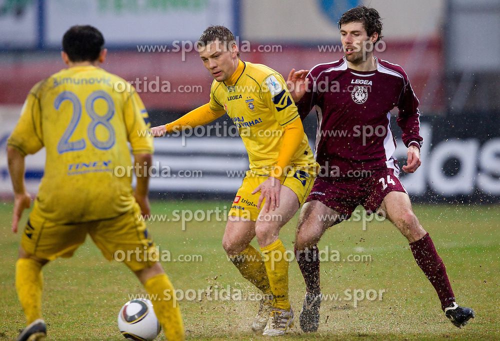 Damir Pekic of Domzale vs Petar Stojnic of Triglav in action during football match between NK Domzale and Triglav Gorenjska in 23rd Round of 1st Slovenian League PrvaLiga, on March 16, 2011 in Sports park Domzale, Domzale, Slovenia. Domzale defeated Triglav 3-1. (Photo By Vid Ponikvar / Sportida.com)