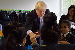 Michaela Community School, Wembley, London, June 23rd 2015. Mayor of London Boris Johnson visits the Michaela Community School, a Free School in Wembley that started taking students in September2014 after battling a certain amount of resistance from locals and unions. During the visit Head Teacher Katharine Birbalsingh took the Mayor on a tour of the school before he participated in a history lesson, prior to sitting down with pupils for brunch. PICTURED: Mayor of London greets pupils as he joins them for brunch.