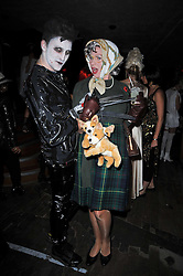 Left to right, designer HENRY HOLLAND and ROSIE ? at the 3rd annual Browns Focus Halloween Party held at the Shepherd's Bush Pavilion, London W12 on 30th October 2009.