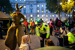 © Licensed to London News Pictures. 09/10/2019. London, UK. Extinction Rebellion activists dress as Kangaroos at a  roadblock in Parliament Square as police try to remove protesters. Police continue to attempt to clear roads in Westminster on the third day of the protest.  Photo credit: George Cracknell Wright/LNP
