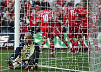 Photo: Paul Thomas.<br /> Liverpool v Blackburn Rovers. The Barclays Premiership. 14/10/2006.<br /> <br /> Brad Friedel (L) the Blackburn keeper pulls up his socks as Liverpool celebrate Craig Bellamy's goal.